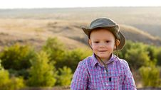 Free Young Boy In Open Countryside Royalty Free Stock Photo - 26718725