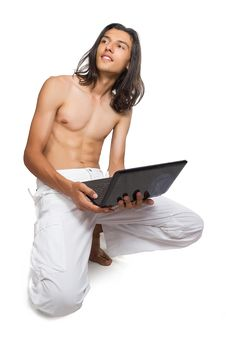 Free Portrait Of A Young Man Using A Laptop Stock Photography - 26720252