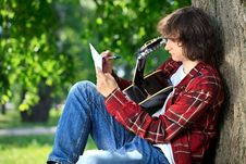 Free Man Composing Song Stock Images - 26727294