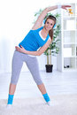 Free Young Woman Stretching Royalty Free Stock Photo - 26731045