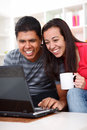 Free Happy Young Couple Looking At A Laptop Stock Images - 26731804