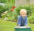 Free Little Baby Boy Gardener Playing Stock Images - 26737274