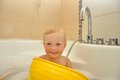 Free Happy Child Bathes In A Bathroom Royalty Free Stock Photos - 26737938