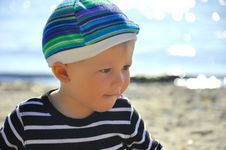 Free Cute Boy Playing On A Beach Stock Photo - 26735910