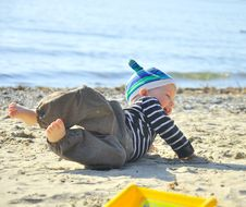 Free Cute Boy Playing On A Beach Stock Images - 26736054