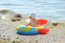 Cute Boy Rowing A Boat On A Beach Royalty Free Stock Photos