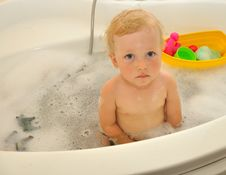 Free Happy Child Bathes In A Bathroom Stock Image - 26737621
