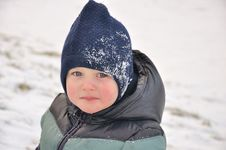 Boy Sliding In The Snow Royalty Free Stock Images