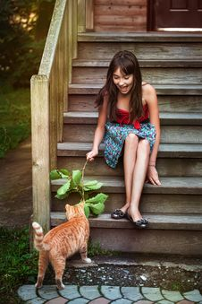 Free Girl Playing With Cat Stock Image - 26747561