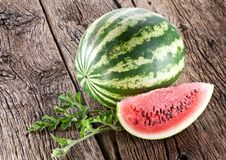 Free Watermelon With A Slice And Leaves Royalty Free Stock Images - 26759679