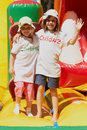 Free Cute Little Sisters In A Jumping Castle Stock Photography - 26765282