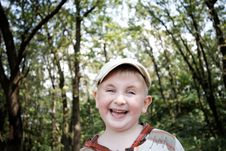 Free Laughing Boy In The Woods Royalty Free Stock Image - 26770636