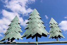 Free Metal Pine Trees Against Bright Blue Sky Stock Images - 26778774