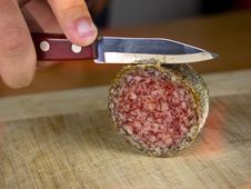 Free Cutting Salami On A Wooden Board Royalty Free Stock Photography - 26783917