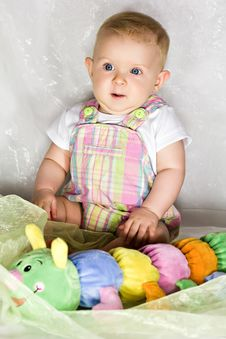 Free Astonished Infant With Toy Royalty Free Stock Image - 26786646