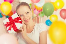 Free Young Woman With A Gift With Colorful Balloons Royalty Free Stock Photo - 26791905