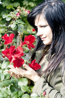 Beautiful Brunette Near Red Roses Stock Image