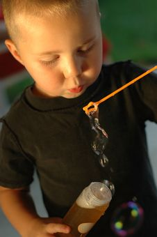 Free Boy Blowing Bubbles Stock Photo - 2684520