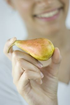 Free Girl Holding Pear Royalty Free Stock Images - 2685099