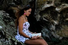 Free Beauty Girl On The Rock With Book Royalty Free Stock Image - 26815346
