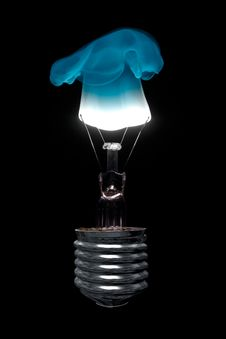 Free Burning Light Bulb With Blue Flame Royalty Free Stock Image - 26818186