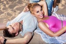 Free Happy Couple Lying Together On Sand - Romance Royalty Free Stock Images - 26819489