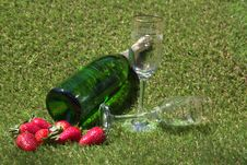 Champagne Bottle, Glasses And Strawberries On The Royalty Free Stock Photos