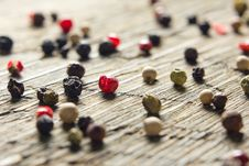 Free Peppercorn Mix On Vintage Worn Wood Royalty Free Stock Images - 26821679
