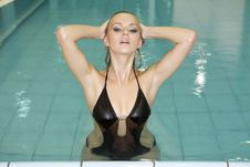 Free Beautiful Young Woman Standing In A Swimming Pool Stock Images - 26825404