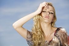 Free Beautiful Girl On Background Blue Sky Royalty Free Stock Images - 26825549