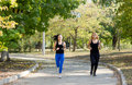 Free Two Women Jogging In A Park Stock Photos - 26838043