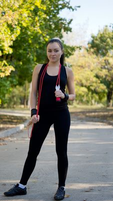 Free Fit Attractive Woman With Skipping Rope Royalty Free Stock Image - 26838076