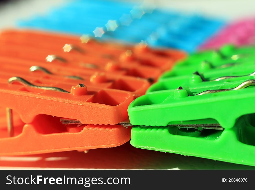 Colored plastic clothes pegs