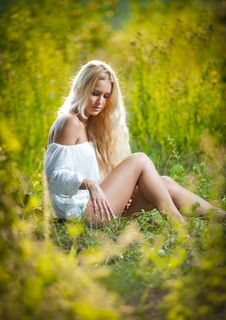 Young Woman On Field In White Dress Royalty Free Stock Photo