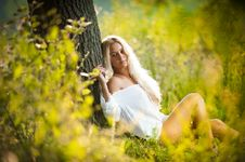 Young Woman On Field In White Dress Royalty Free Stock Photography