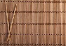 Free Two Chopsticks On Sushi Background Royalty Free Stock Photos - 26857868