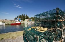 Lobster Traps And Fishing Boats Royalty Free Stock Image