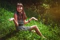 Free Girl Sitting On A Grass Royalty Free Stock Images - 26871339