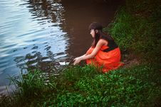 Free Girl Sitting By A Lake Royalty Free Stock Photos - 26871538