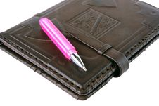 Free Pink Pen Lies On A Notebook Royalty Free Stock Photography - 26874847
