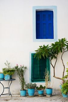Wall With Colored Windows, Poros, Greece Royalty Free Stock Photo