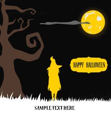 Halloween Witch Standing In Yellow Moon Light Stock Photo