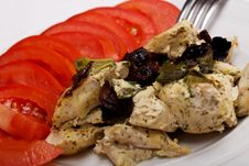 Close-up Chicken Breast With Prunes And Tomatoes