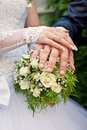 Free Hands On The Wedding Bouquet Stock Photo - 26895700