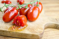 Free Plum Tomatoes Over Cutting Board Stock Image - 26898521