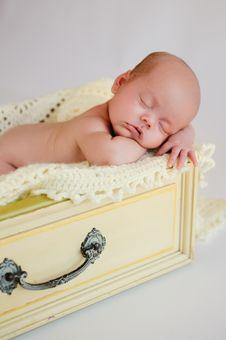 Free Newborn Baby Girl Sleeping In Yellow Drawer Stock Images - 26891694