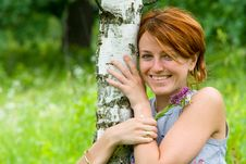Free Smiling Girl And Birch Tree Stock Photography - 2692712