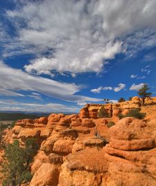 Free Clouds On A Red Canyon Stock Photo - 2697140