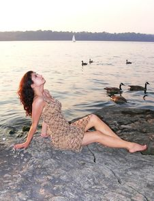 Free Lady On The Lake In Sunset Royalty Free Stock Photo - 2698535