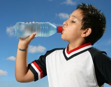 Free Thirsty Boy Drinking Water Out Royalty Free Stock Photo - 2698545